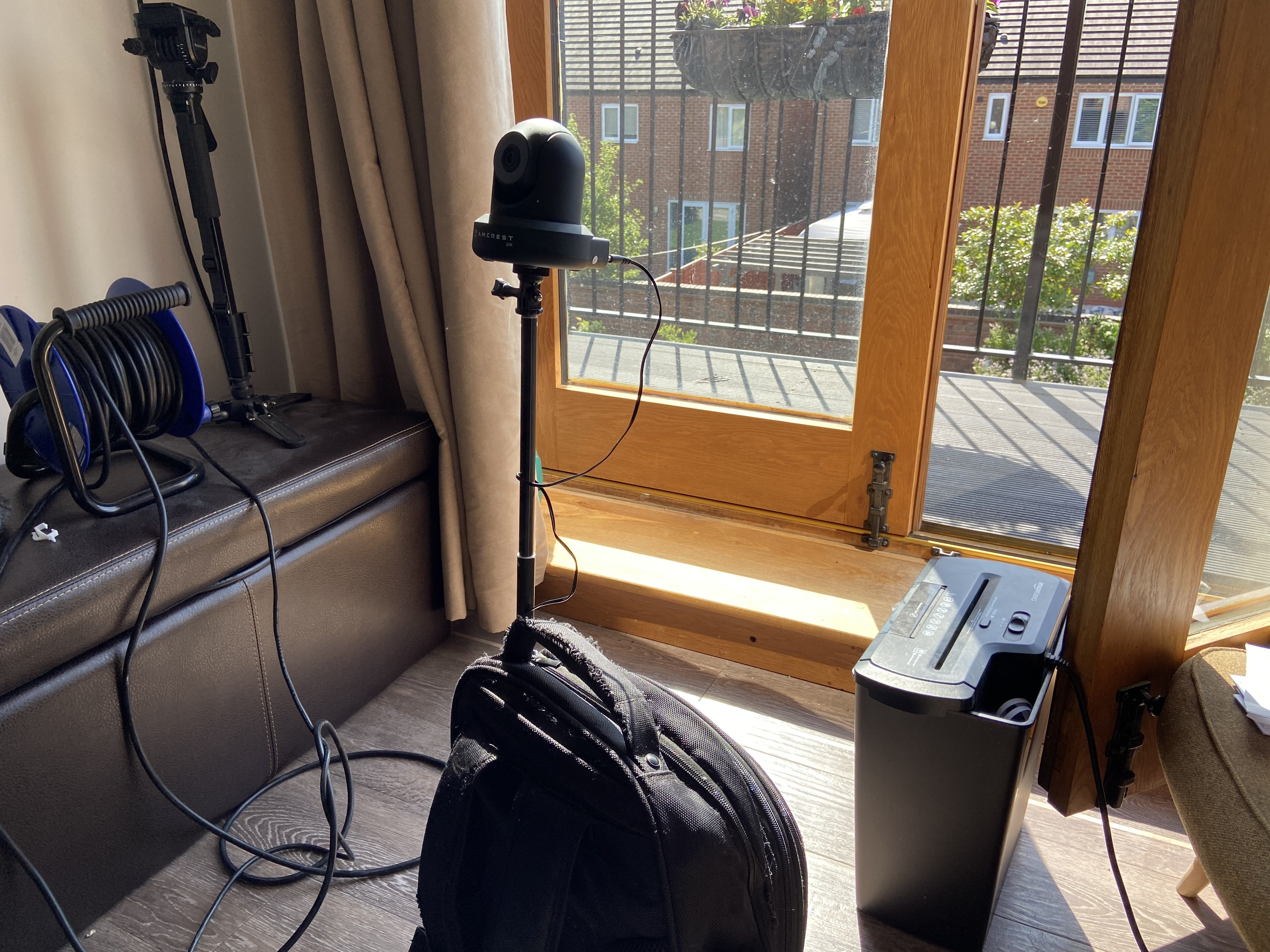 My rucksack which has a selfie stick poking out of it, on top of the stick is a pan/tilt security camera